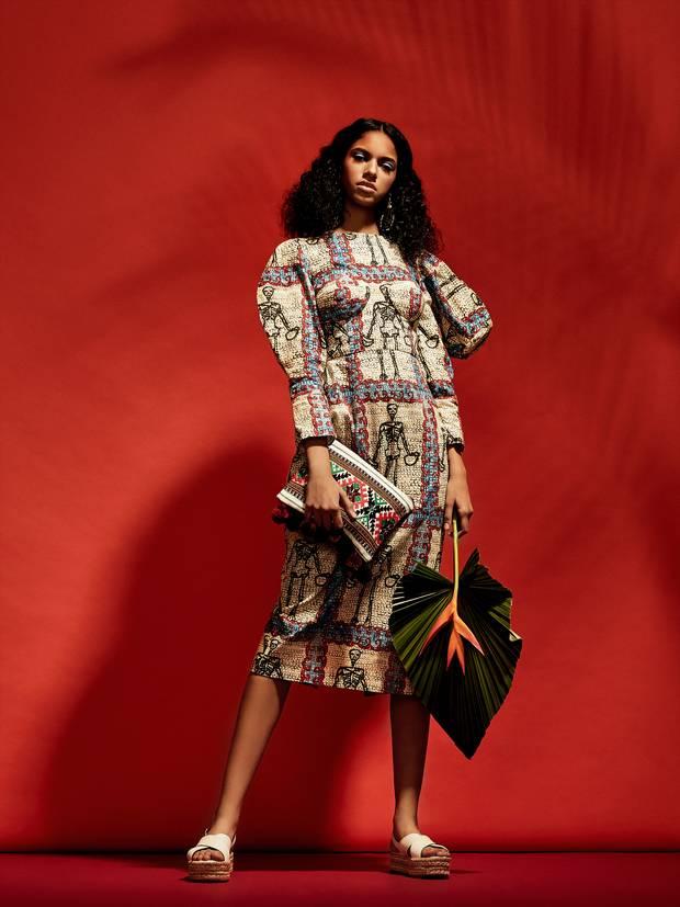 Tata Naka dress, £729 through www.tatanaka.com. Bag, $89 through www.lifeofmanek.com. Prada shoes, $885 at Nordstrom (www.nordstrom.com). This Ilk earrings, $62 through www.thisilk.com.