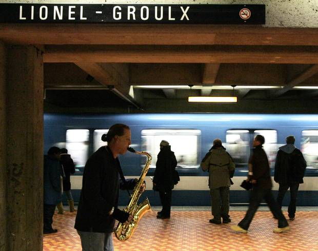 A busker plays the Lionel Groulx metro (subway) station in Montreal in this 2008 file photo.