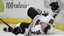 Chicago Blackhawks defenseman Brent Seabrook falls to the ice after he was checked by Anaheim Ducks defenseman James Wisniewski in the second period of an NHL hockey game in Anaheim, Calif., Wednesday, March 17. (Jae C. Hong/Associated Press)