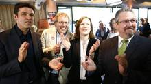 Members of the Gripen referendum committee National Councillor Matthias Aebischer (L-R), former National Councillor Jo Lang, National Councillors Evi Allemann and Beat Flach react following the results on the vote in Bern May 18. (RUBEN SPRICH/REUTERS)