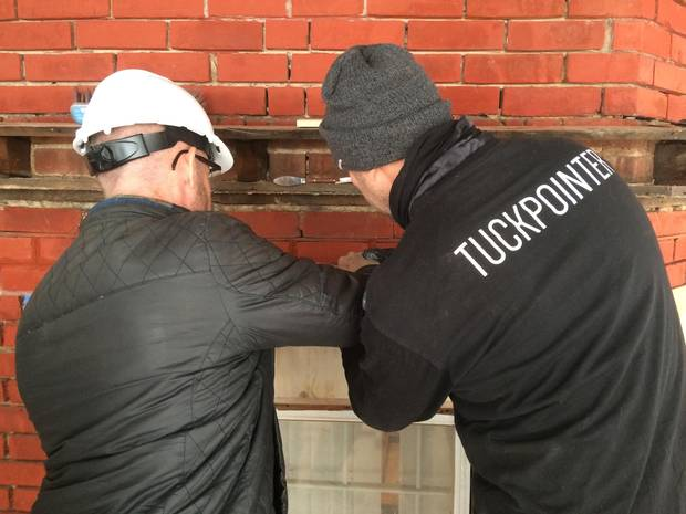 Melbourne-based master tuckpointer Antoni Pijaca instructs a student on the fine art of tuckpointing.