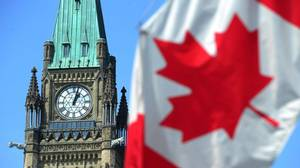 The Peace Tower and a Canadian flag are seen on Parliament Hill in Ottawa on Wednesday, April 27, 2011.