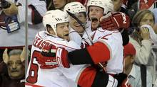 Carolina Hurricanes Eric Staal celebrates with teammates Joni Pitkanen (C) and Tim Gleason (L) after scoring the game-winning goal against the New Jersey Devils in the third period of Game 7 of the NHL Eastern Conference quarterfinals hockey playoffs in Newark, New Jersey April 28, 2009. (RAY STUBBLEBINE/Associated Press)