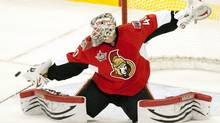 Ottawa Senators goalie Robin Lehner deflects a shot during first period NHL action in Ottawa, on Sunday February 26, 2012. THE CANADIAN PRESS/Adrian Wyld (Adrian Wyld/CP)