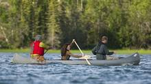 The Duke and Duchess of Cambridge take a canoe ride with elder Francois Paulette from the Fort Smith area at Lake Blatchford Lake, N.W.T., lodge on July 5, 2011. (Nathan Denette/THE CANADIAN PRESS)