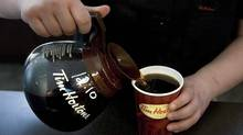 While Tim Hortons' earnings may be solid, the best news investors could get is the naming of a new CEO – preferably one with a track record of growth in the U.S. quick-service restaurant business. (Chris Young/Canadian Press/Chris Young/Canadian Press)