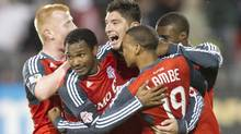 Toronto FC 's Miguel Aceval (centre) celebrates scoring his team's equaliser against Santos Laguna with Richard Eckersley (left) Julian De Guzman (centre left) Reggie Lambie (centre right) and Ashtone Morgan during first half action in the CONCACAF Champions League semifinal in Toronto. (Chris Young/The Canadian Press)