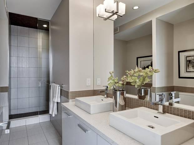 The bathroom has a standalone shower and deep bathtub.