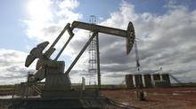 An oil well and storage tanks in Belfield, N.D., are in the Bakken shale formation. (JIM WILSON/NYT)
