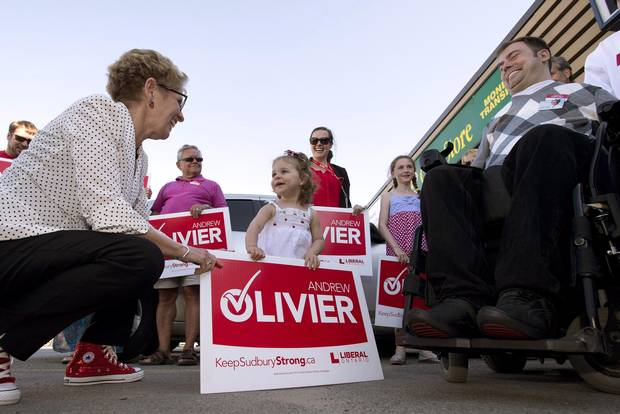 Ontario Premier Kathleen Wynne, left, greets supporters at a campaign event for Liberal candidate Andrew Olivier, right, in Sudbury in May, 2014.