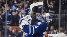 Toronto Maple Leafs goaltender James Reimer celebrates after saving a shot from Washington Capitals' Troy Brouwer (not shown) to win during shootout NHL action in Toronto on Saturday November 23, 2013. (Chris Young/THE CANADIAN PRESS)