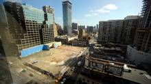 The site at the corner of Yonge and Bloor streets has been cleared and waits for a revised development plan from new owner Great Gulf Homes. (Fred Lum/Fred Lum/THE GLOBE AND MAIL)