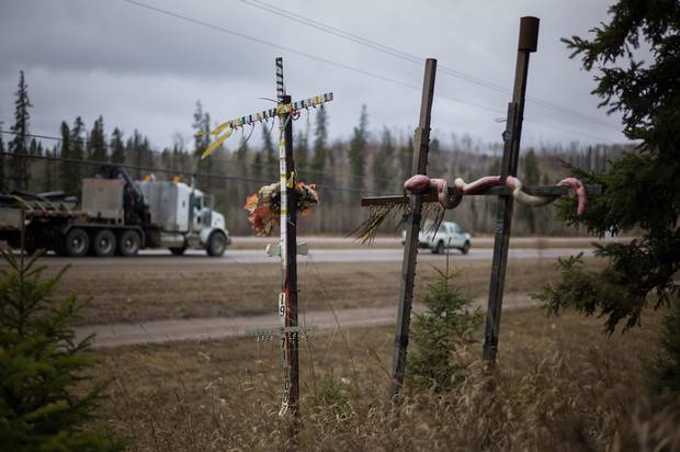 A roadside memorial is seen along highway 63, just north of Fort McMurray.