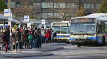 Students line up to catch the bus at the UBC bus loop in Vancouver on Monday. (Jeff Vinnick For The Globe and Mail)