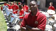 Salmon Cupid director of the Toronto All Stars Steel Orchestra, with student members of the group in Jume 2011. Students will have less exposure to steel orchestra if the cuts to the itinerant music program are approved. (Fernando Morales/The Globe and Mail)