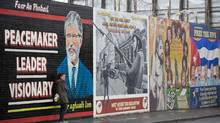 This mural along the Falls Road of Belfast portrays Sinn Fein firebrand Gerry Adams as a contemporary statesman. The police are more interested in his past. (PAUL HACKETT/Reuters)