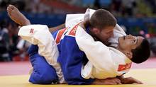 Canada's Sasha Mehmedovic fights with El Salvador's Carlos Figueroa (white) during their men's -66kg elimination round of 64 judo match, at the London 2012 Olympic Games July 29, 2012. (Reuters)