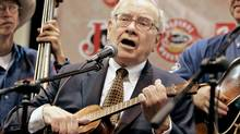 Billionaire investor Warren Buffett plays with a western band at the Justin Brands stage, during the annual Berkshire Hathaway shareholders meeting in Omaha, Neb., Saturday, May 5, 2007. (Nati Harnik)