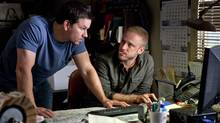 "Mark Wahlberg (left) and Ben Foster in a scene from ""Contraband."" (Patti Perret/AP/Universal Pictures)"