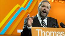 NDP Leader Thomas Mulcair addresses delegates following a confidence vote during the party's weekend convention in Montreal in this April 13, 2013, photo. (Paul Chiasson/The Canadian Press)
