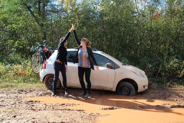 The duo's Toyota stuck in PEI mud.