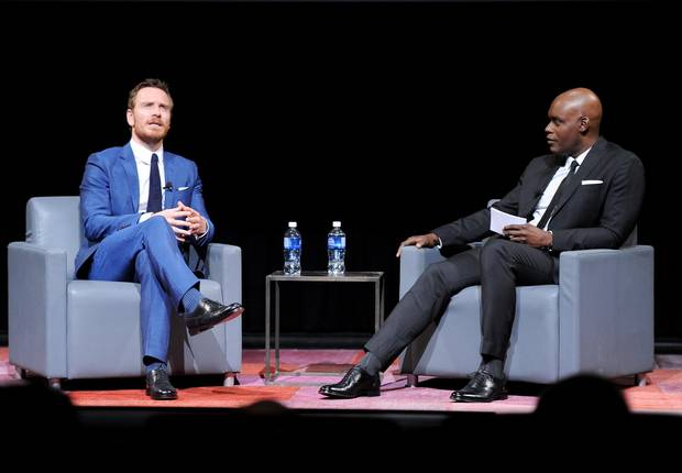 Actor Michael Fassbender and TIFF Artistic Director Cameron Bailey speak onstage at the TIFF Soiree during the 2016 Toronto International Film Festival at TIFF Bell Lightbox on September 7, 2016 in Toronto, Canada.