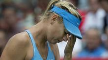 Maria Sharapova reacts during her match against Carla Suarez Navarro during the round of sixteen at the Rogers Cup tennis tournament Thursday August 7, 2014 in Montreal. (The Canadian Press)