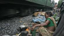 Life beside the tracks in India: Open defecation remains the only option for hundreds of millions of impoverished people (Reuters)
