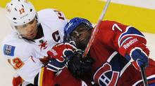 Montreal Canadiens' PK Subban (76) collides with Calgary Flames' Jerome Iginla during third period NHL hockey action in Montreal, Thursday, October 13, 2011. THE CANADIAN PRESS/Graham Hughes (Graham Hughes/CP)