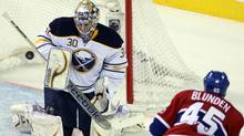 Buffalo Sabres goalie Ryan Miller makes a save against Montreal Canadiens right wing Michael Blunden. (Ryan Remiorz/The Canadian Press/Ryan Remiorz/The Canadian Press)