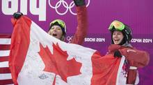 Canadains Dara Howell (L) who won gold and Kim Lamarre who won bronze celebrate their medal wins at the Rosa Khutor Extreme Park after February 11, 2014. (John Lehmann/The Globe and Mail)