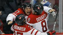 Canada's Sidney Crosby celebrates with teammates Scott Niedermayer (L) and Drew Doughty after scoring the game winning goal against the U.S. during overtime in their men's ice hockey gold medal game at the Vancouver 2010 Winter Olympics February 28, 2010. (TODD KOROL)