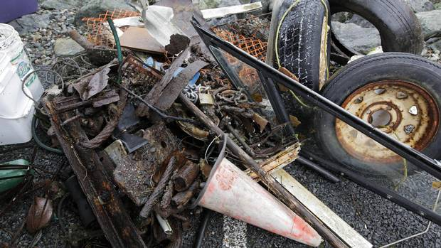 A pile of scrap metal, chains, tires, a pylon, boat window, plastic fencing, and a garden hose are some of the items found during the Surfrider Pacific Rim Christmas Jingle Cleanup Event along the Tofino harbour shorefront near the 4th Street government dock and marina on December 2, 2016.