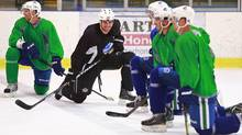Willie Mitchell of the Los Angeles Kings smiles as he chats with former teammates on the Vancouver Canucks as they participate in an informal skate at UBC in Vancouver Se