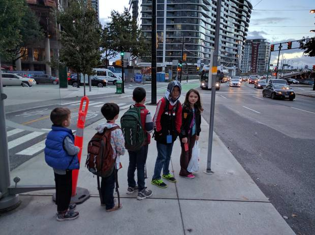 Adrian Crook's kids wait for the bus.