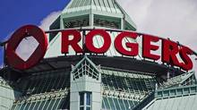 The Rogers sign is seen atop the Rogers Communications Inc. headquarters in Toronto. The Canadian telecom giant is nearing the end of its search for a new chief executive officer, and a British telecom executive has emerged as the front-runner for one of corporate Canada's biggest jobs. (MARK BLINCH/REUTERS)