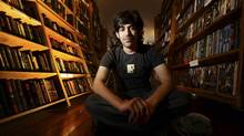 Aaron Swartz poses in a Borderland Books in San Francisco on February 4, 2008. Internet activist and programmer Swartz, who helped create an early version of RSS and later played a key role in stopping a controversial online piracy bill in Congress, has died at age 26, an apparent suicide, New York authorities said January 13, 2013. (Noah Berger/Reuters)