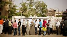Egyptian voters line up to cast ballots in Basateen, a southern suburb of Cairo, on May 23, 2012. (Pete Muller/AP/Pete Muller/AP)