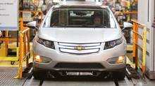 The first pre-production Chevrolet Volt rolls off the line at the Detroit-Hamtramck manufacturing plant in Detroit last March 31. (HO/Reuters)