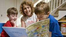 Sindy Preger reads French books to her 4-year-old twin boys Levi and Reuben. (JENNIFER ROBERTS/JENNIFER ROBERTS FOR THE GLOBE AND MAIL)