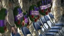 Canadians soldiers line up with wreaths to commemorate fallen Canadian soldiers during a next of kind memorial ceremony with family members at their base at Kandahar Airfield, Afghanistan, Saturday, Sept. 4, 2010. The latest death brings to 152 the number of Canadian military personnel who have died since the Afghan mission began in 2002. (Anja Niedringhaus/AP/Anja Niedringhaus/AP)