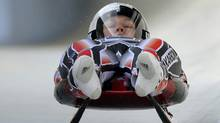 Alex Gough from Canada speeds down the track during a practice session of the Women's Single Luge event at the Luge World Championships in Altenberg, Germany, Friday. (Matthias Rietschel)