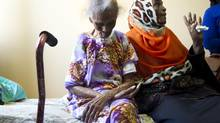 Saido Hersi, right, helps to explain how the trauma from last week's police raids, impacted both physically and mentally upon her 96 year-old mother, Faduma Hersi, who lives at 340 Dixon Road, in Toronto on July 18, 2013. (Peter Power/The Globe and Mail)