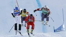 Armin Niederer of Switzerland, centre with red bib, performs during the final race on his way to win the men's ski cross World Cup event of Val Thorens, French Alps, ahead Brady Leman of Canada, right with green bib, Joe Swensson of USA, left with blue bib, and David Duncan of Canada, with yellow bib, Wednesday, Dec. 19, 2012. (Laurent Cipriani/AP)