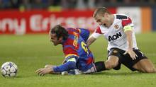 C Basel's (FCB)  Marco Streller (L) fights for the ball with Nemanja Vidic of Manchester United during their Champions League Group C soccer match in Basel December 7, 2011. (Reuters)