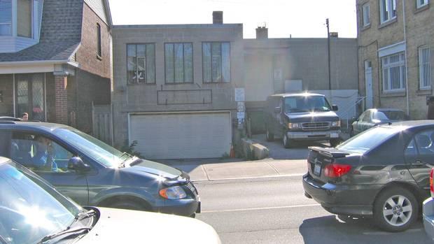 The grey cinder block Christie Street façade, prior to redevelopment.