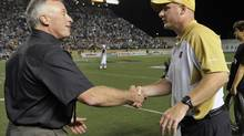 Winnipeg Blue Bombers head coach Paul LaPolice (R) is congratulated by Vice-President and General Manager of Football Operations Joe Mack after defeating the Edmonton Eskimos during their CFL game in Winnipeg, July 26, 2012. (FRED GREENSLADE/REUTERS)