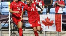 Canada's Christine Sinclair (R) celebrates with her team mate Jonelle Filigno after scoring a goal against South Africa during their women's Group F soccer match at the London 2012 Olympic Games in the City of Coventry Stadium July 28, 2012. (ALESSANDRO GAROFALO/REUTERS)