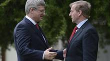 Canadian Prime Minister Stephen Harper and Irish Prime Minister Enda Kenny talk outside Farmleigh House in Dublin, Ireland, Sunday, June 16, 2013. (Adrian Wyld/THE CANADIAN PRESS)