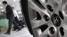 A new study by the U.S. National Automobile Dealers Association (NADA) and the Canadian Automobile Dealers Association urges auto makers and dealer associations to work together to establish guidelines that will satisfy the companies' needs for modern and attractive stores, but at reduced cost. (KIM HONG-JI/REUTERS)
